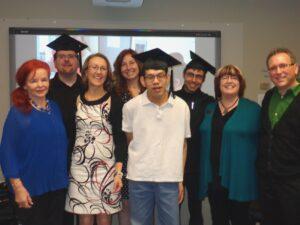 graduates and staff